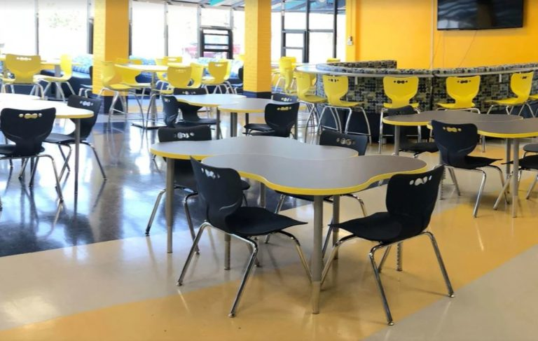 school cafeteria and dining area with tables and chairs